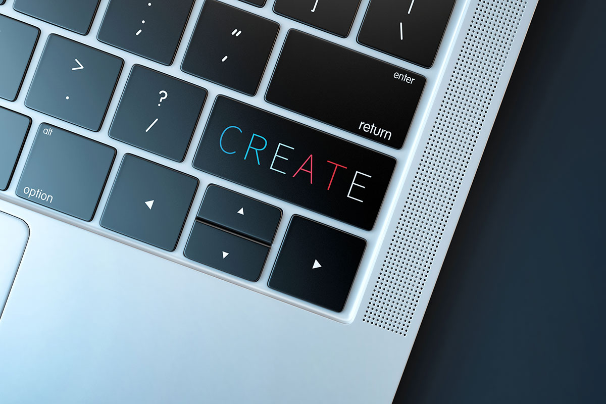 Canva - Keyboard Detail Of A Laptop That Says Create